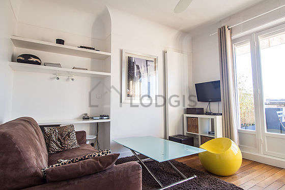 Quiet living room furnished with 1 sofabed(s) of 120cm, tv, hi-fi stereo, wardrobe
