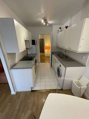 Kitchen where you can have dinner for 4 person(s) equipped with hob, refrigerator, crockery