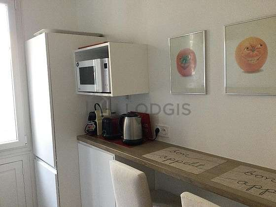 Kitchen where you can have dinner for 2 person(s) equipped with dishwasher, hob, refrigerator, extractor hood