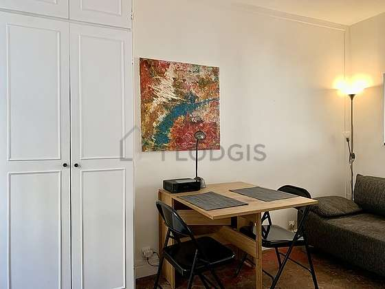 Quiet living room furnished with 1 bed(s) of 140cm, tv, dvd player, wardrobe