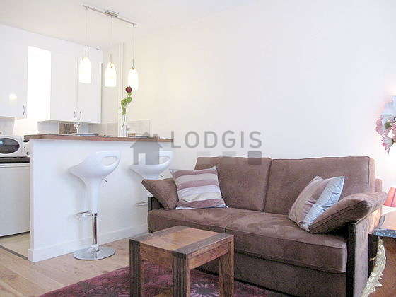 Quiet living room furnished with 1 sofabed(s) of 140cm, tv, hi-fi stereo