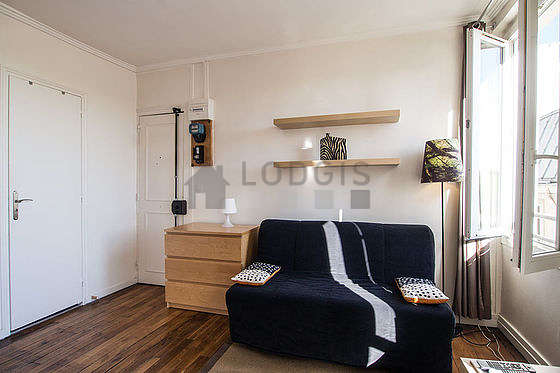 Bright living room furnished with cupboard, 4 chair(s)