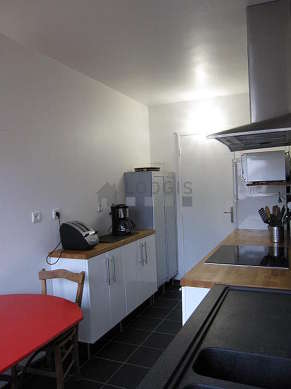 Bright kitchen with double-glazed windows facing the garden