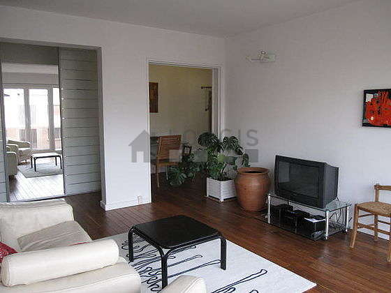 Quiet living room furnished with tv, hi-fi stereo, 1 armchair(s), 1 chair(s)