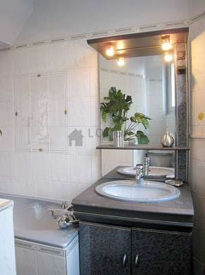 Beautiful and bright bathroom with windows and with tilefloor