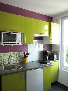 Bright kitchen with double-glazed windows facing the courtyard