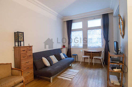 Quiet living room furnished with 1 bed(s) of 140cm, 1 sofabed(s) of 140cm, tv, dvd player