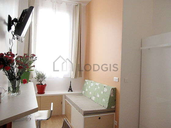 Bright living room furnished with wardrobe, cupboard