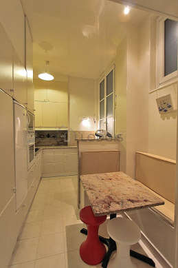 Kitchen where you can have dinner for 3 person(s) equipped with washing machine, dryer, refrigerator, crockery