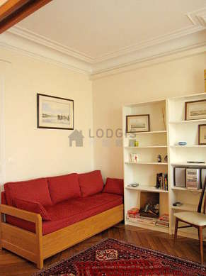 Quiet living room furnished with tv, hi-fi stereo, storage space, 1 chair(s)