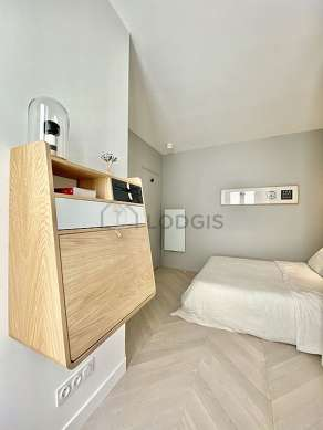 Bedroom equipped with tv, bedside table