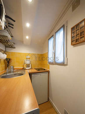 Kitchen equipped with washing machine, refrigerator, freezer, crockery