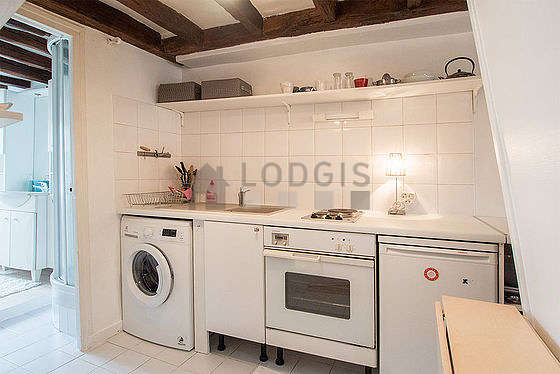 Kitchen where you can have dinner for 2 person(s) equipped with washing machine, refrigerator, crockery