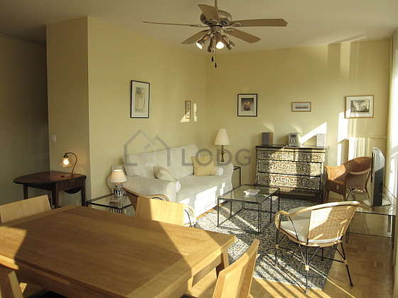 Very quiet living room furnished with tv, hi-fi stereo, 3 armchair(s), 4 chair(s)