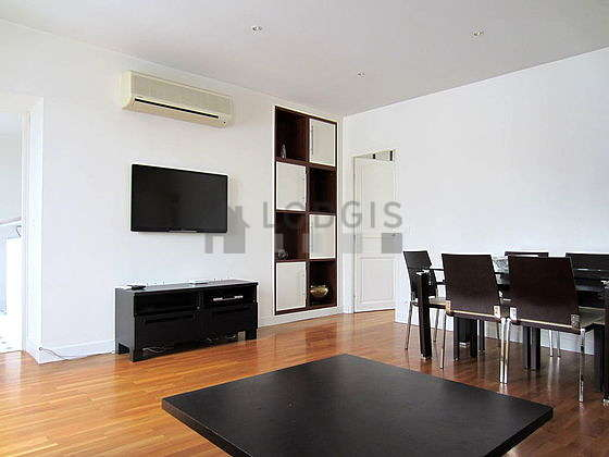 Very quiet living room furnished with air conditioning, tv, hi-fi stereo, cupboard