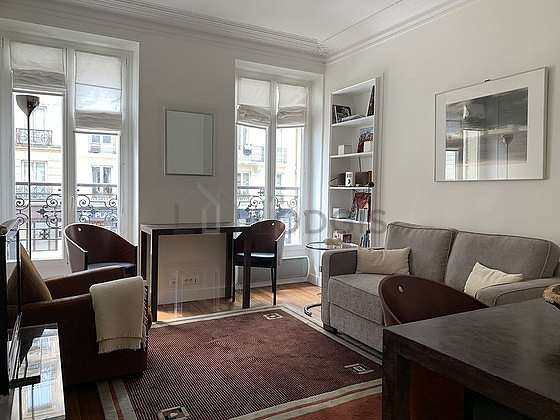 Very quiet living room furnished with tv, hi-fi stereo, 3 armchair(s), 2 chair(s)