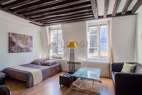 Quiet living room furnished with 1 bed(s) of 140cm, tv, hi-fi stereo, wardrobe