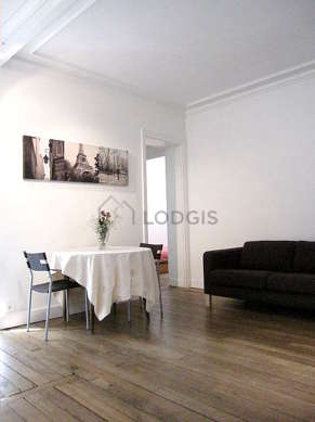 Very quiet living room furnished with tv, hi-fi stereo, cupboard, 4 chair(s)