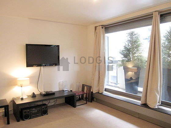 Very quiet living room furnished with 1 bed(s) of 180cm, tv, hi-fi stereo, wardrobe