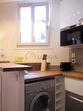 Kitchen where you can have dinner for 2 person(s) equipped with hob, freezer, extractor hood, crockery