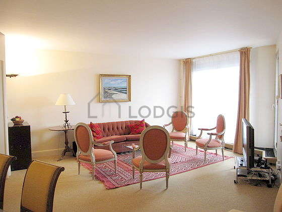 Very quiet living room furnished with tv, 4 armchair(s), 6 chair(s)