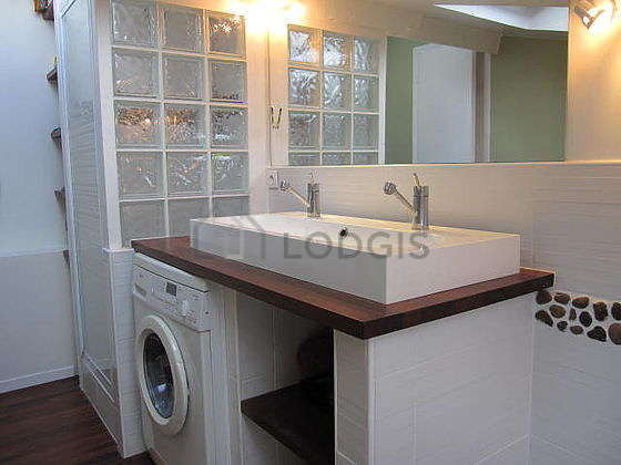 Pleasant and bright bathroom with windows and with woodenfloor