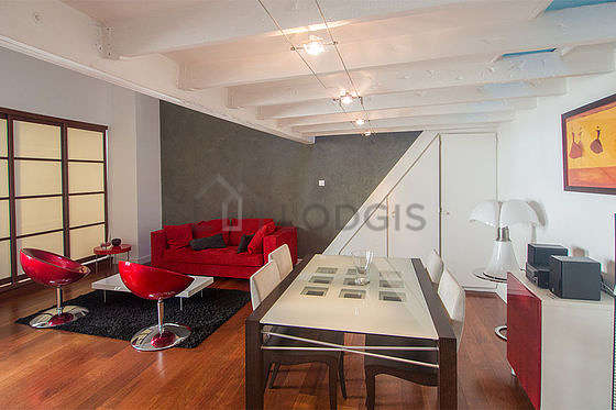 Very quiet living room furnished with tv, hi-fi stereo, 2 armchair(s), 8 chair(s)