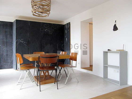 Bright living room furnished with cupboard, 6 chair(s)