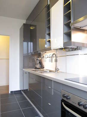 Bright kitchen with double-glazed windows and balcony facing the road