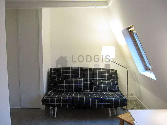 Quiet living room furnished with 1 sofabed(s) of 140cm, dining table, coffee table, wardrobe
