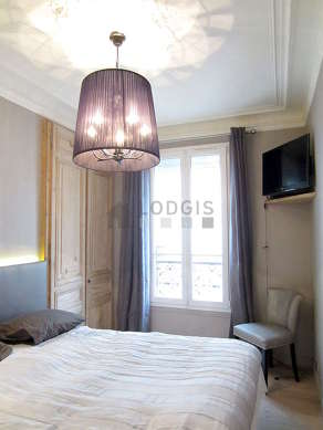 Chambre de 11m² avec du parquetau sol