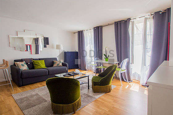 Quiet living room furnished with 1 bed(s) of 90cm, 1 sofabed(s) of 140cm, tv, hi-fi stereo