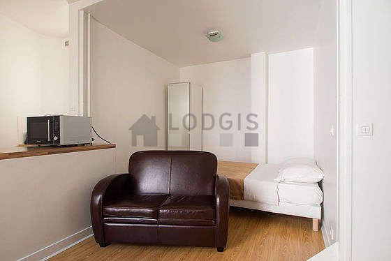 Very quiet living room furnished with 1 bed(s) of 140cm, tv, cupboard