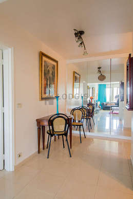 Beautiful entrance with tilefloor and equipped with 2 chair(s)