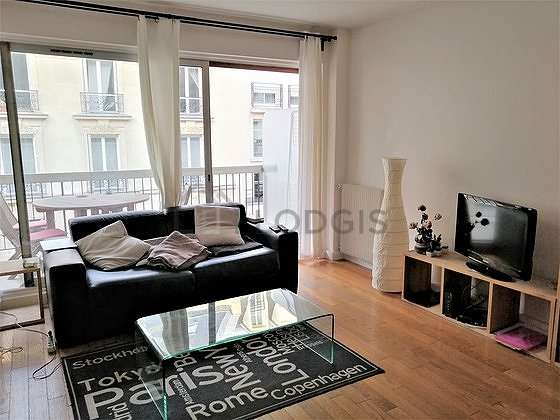 Quiet living room furnished with 1 sofabed(s) of 140cm, 1 murphy bed(s) of 140cm, tv, wardrobe