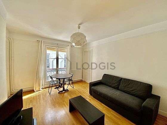 Beautiful bright sitting room of an apartmentin Paris