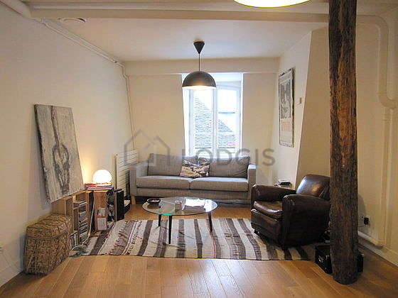 Quiet living room furnished with hi-fi stereo, 1 armchair(s)