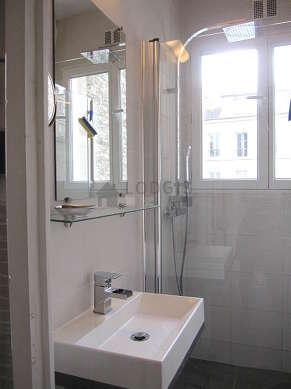 Bathroom with double-glazed windows and with tilefloor