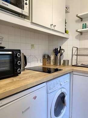 Kitchen equipped with washing machine, dryer, refrigerator, crockery