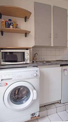 Kitchen equipped with washing machine, refrigerator, freezer, crockery