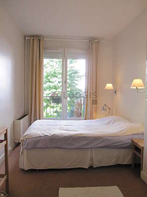 Bedroom with windows and balcony facing the garden