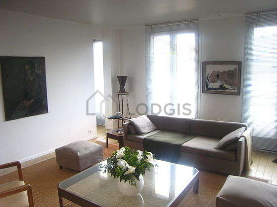Very quiet living room furnished with dvd player, 2 armchair(s), 3 chair(s)