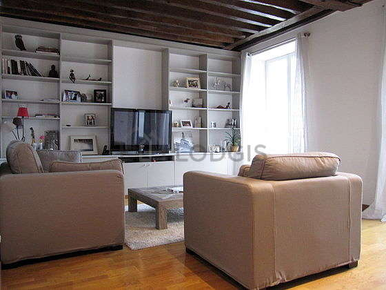 Very quiet living room furnished with tv, hi-fi stereo, 1 armchair(s), 2 chair(s)