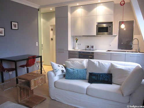 Quiet living room furnished with 1 sofabed(s) of 140cm, tv, cupboard, 2 chair(s)
