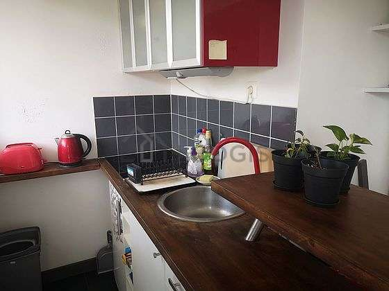 Kitchen with double-glazed windows facing the garden