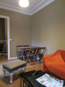 Very quiet living room furnished with tv, 2 armchair(s), 4 chair(s)