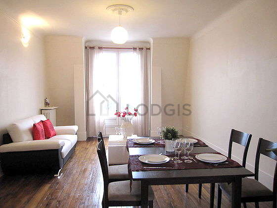 Quiet living room furnished with sofa, coffee table, wardrobe, cupboard