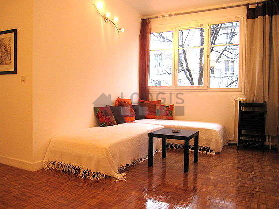 Quiet living room furnished with 2 bed(s) of 80cm, tv, wardrobe