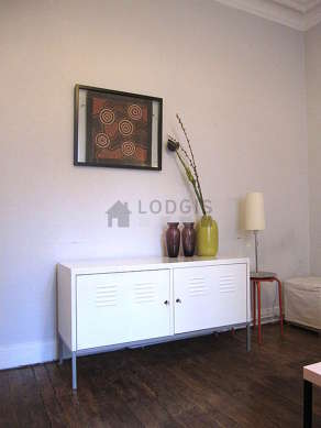 Quiet living room furnished with 1 sofabed(s) of 120cm, tv, storage space, 2 chair(s)