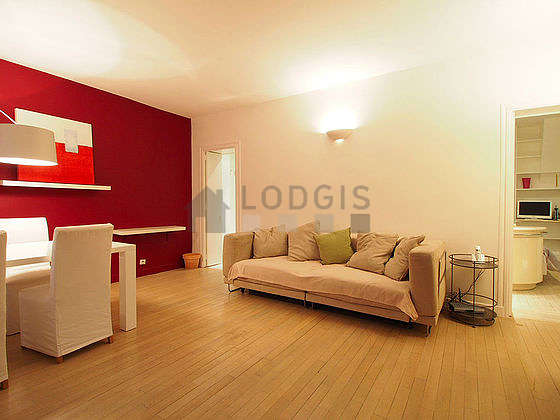 Quiet living room furnished with 1 sofabed(s) of 140cm, hi-fi stereo, wardrobe, cupboard